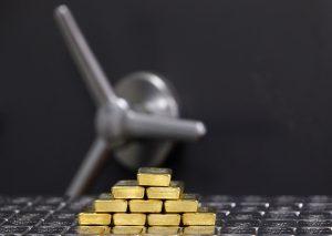 stocks or et argent dans un coffre fort